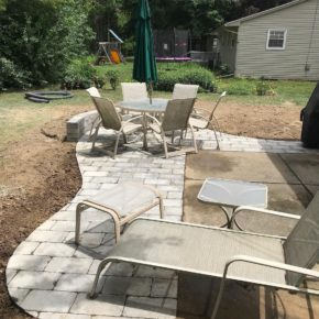 Brick patio with lawnchairs and table
