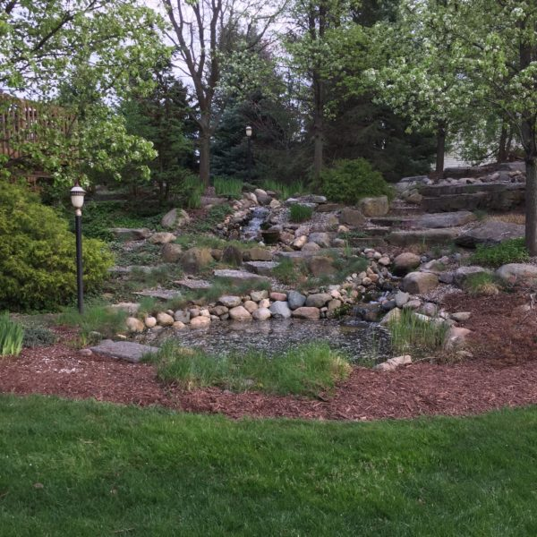Landscape with pond water feature