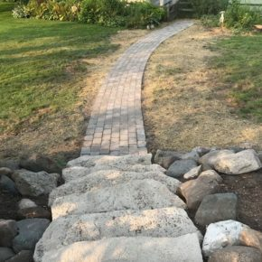 Brick hardscape path through backyard