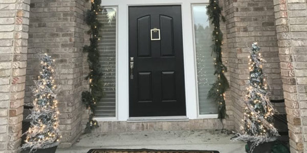 Front door decorated with holiday decor by Bud Branch and Blossom